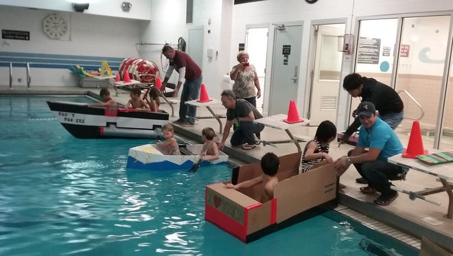 Lining up the cardboard boat entries at the starting line.