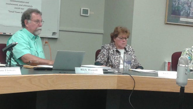 Supervisor Rick Hamill and treasurer Judy Cooper listen to comments during a Highland Township board meeting.
