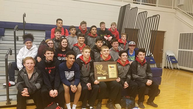 The Parkway wrestling team hold up the plaque they won Saturday in Baton Rouge in the LHSCA D-II Dual Meet.