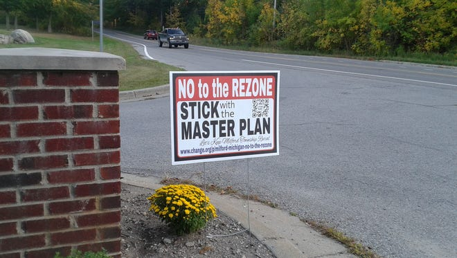 Signs like this asked Milford Township officials last year to reject a developer's rezoning request. They did. The planning commission on April 25 recommended denial of a different rezoning request, also due to its deviation from the master plan.