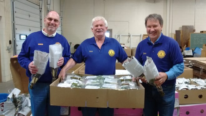 Sturgeon Bay Lions Club members, Greg Virlee,  left, Rob Herland, and Don Ziegelbauer, during the 2017 Roses for Spring Sale.