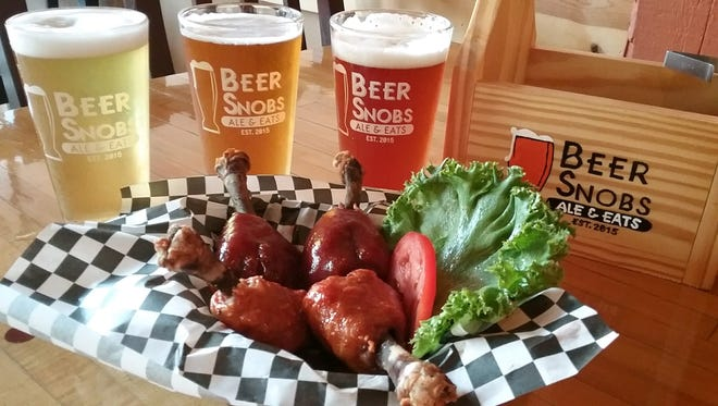 What better way to enjoy Beer Snobs Ale & Eats' 24 different tap beers than with some wings.