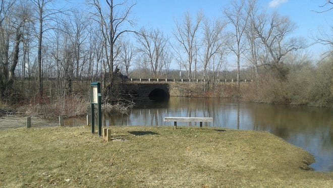 The Wixom Road bridge seen from a picnic area in Proud Lake Recreation Area.