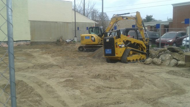 Construction equipment is on site and ready to start working on the foundation of a new mixed use building at Liberty and Main in downtown Milford.