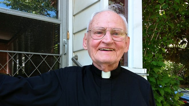 Rev. Alfred Bebel, shown in front of his house in Binghamton, was ordained as a priest 60 years ago.