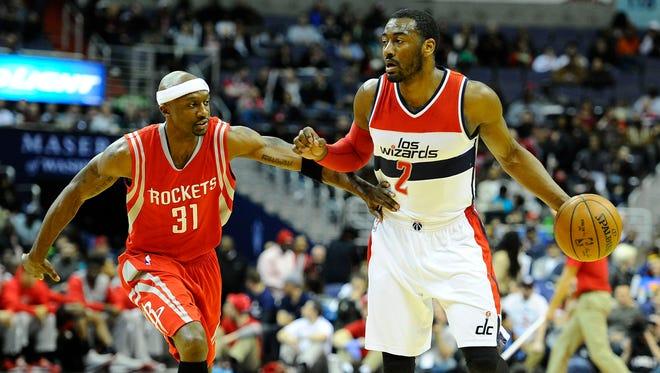 Washington Wizards guard John Wall dribbles as Houston Rockets guard Jason Terry defends at Verizon Center.