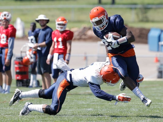 UTEP running back Aaron Jones shrugs off a defender during Wednesday's practice at Camp Ruidoso.