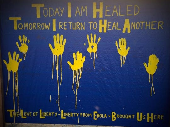 """These are hand prints of foreign Ebola health care workers who were treated and released after being contaminated by the virus in Monrovia. They each proudly put their painted hands under the heading, """"Today I am Healed, Tomorrow I Return to Heal Another."""""""