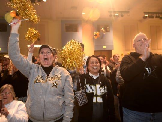 Vanderbilt fans cheer for head coach Derek Mason during