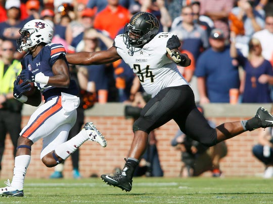 Vanderbilt defensive end Dare Odeyingbo (43) chases