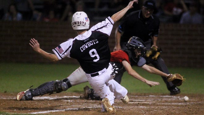 Madison County's Dylan Bass slides into home as the ball gets away from Lafayette catcher Tyler Severance, leading to the game-winning run in the bottom of the eighth inning for the Cowboys during a Region 3-1A final at Suwannee High in Live Oak.