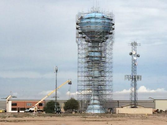 Falcon Field water tower in Mesa far away