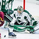 MSU goalie Jake Hildebrand moves to stop a Minnesota shot on goal during a Dec. 5 game in East Lansing. The teams met again Friday, with Minnesota besting MSU.