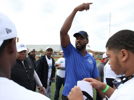 Former Lions receiver Calvin Johnson works with young players during the Calvin Johnson Jr. Foundation Catch a Dream football camp held at Southfield high school Saturday, May 20, 2017 in Southfield.