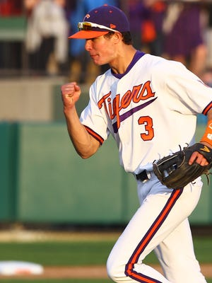 Tyler Krieger celebrates after throwing a runner out during a 2014 game at Clemson.