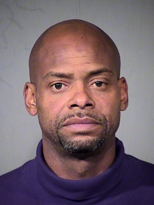 This Thursday Dec.19, 2013 booking photo released by the Maricopa County Sheriff shows Richard Dumas, a former Phoenix Suns player. Dumas was among 151 people arrested in a pre-holiday roundup of theft suspects in Arizona. The U.S. Marshals Service says Dumas was arrested Thursday, Dec. 19, 2013 in Litchfield Park on a warrant charging him with eight counts of organized retail theft.