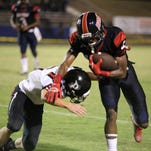 Bastrop's Alfroncius Dowles breaks a tackle by Parkway defender Rayshion Cook during action at Bastrop High School on Friday.