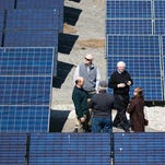 A group from Solar Over Louisville toured the Berea community solar array on March 23, 2016, in Berea, Ky.