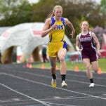 Jaree Mane of Fergus High in Lewistown, center, wins the 200 Saturday at the State A track meet in Bozeman.