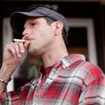 Ed Spencer has a cigarette in Rapid City. A national report shows that nine of South Dakota's top 13 smoking counties are West River.