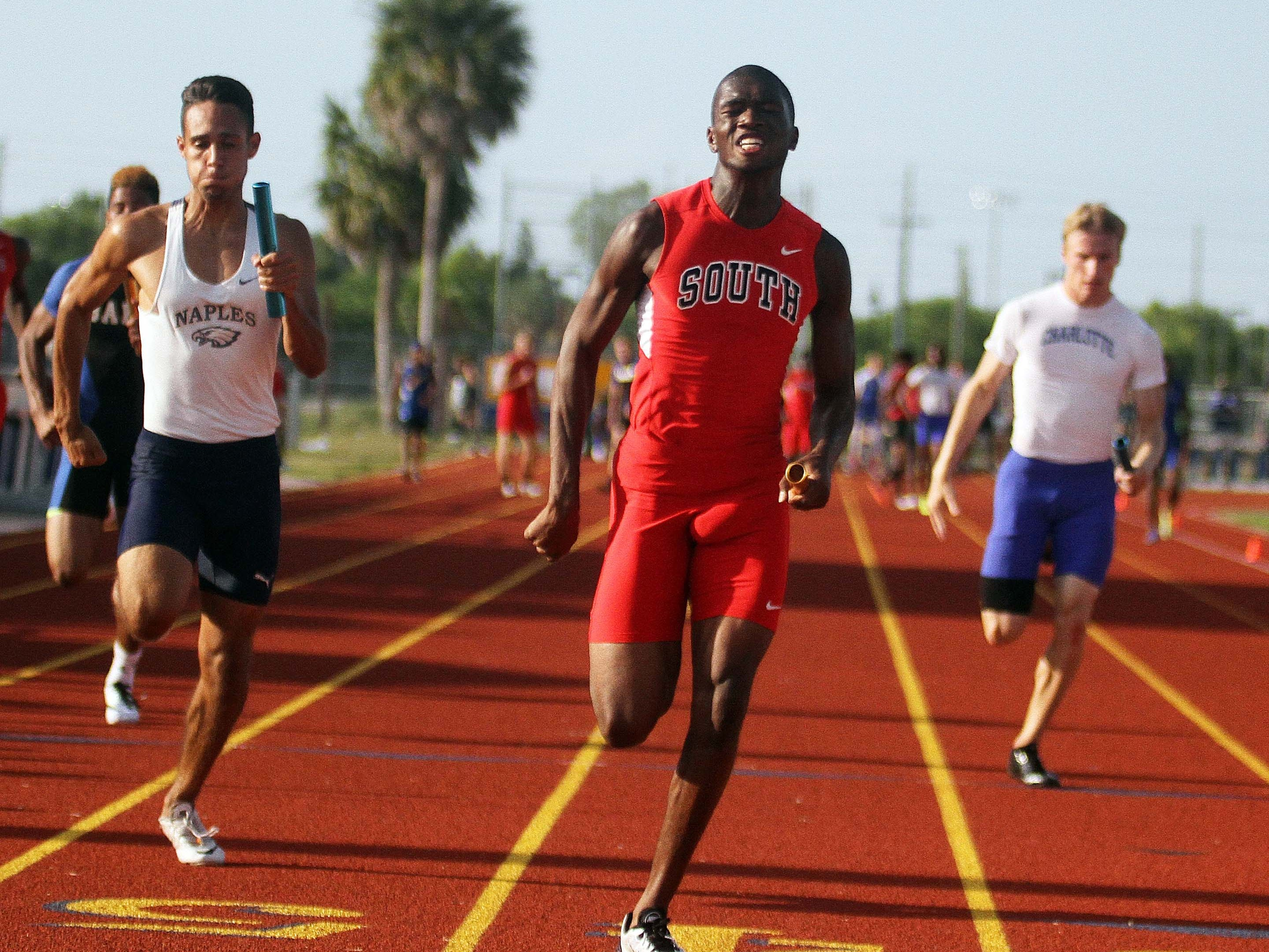 Antonio Wimbush anchors the winning South Fort Myers 400-meter relay team Thursday at the Region 3A-3 track meet at Charlotte High School. The Wolfpack ran a school- and season-best 40.99 seconds.