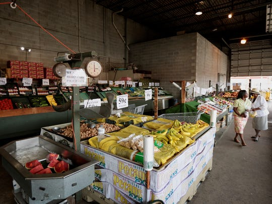 People shop at H&S Produce on Thursday, September 8,