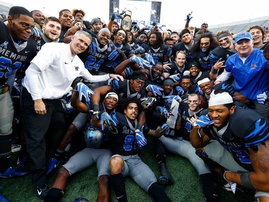 Memphis teammates celebrate their 66-45 victory over