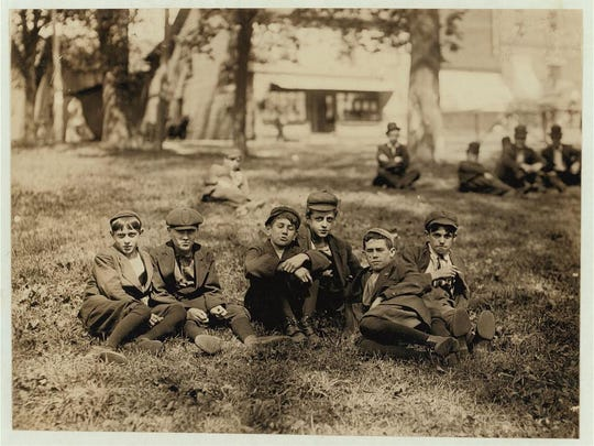 Historic photo by Lewis Hine shows a group of boys working in American Woolen Mills in Winooski. Youngest was 13 and oldest was 15. All had been working one year or more.