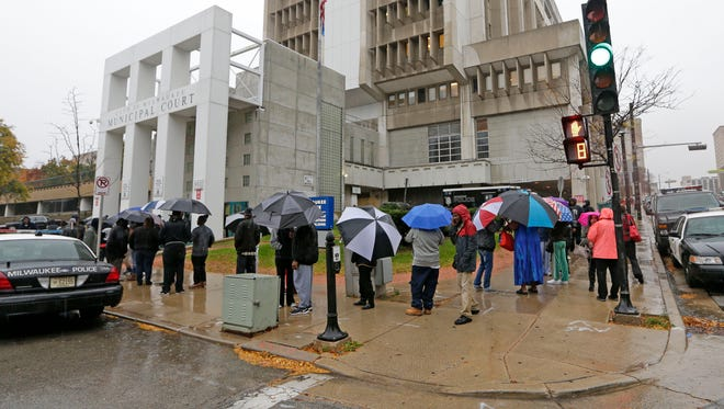 A line of people forms around the block at the Milwaukee Municipal Court on N. James Lovell St. on Wednesday. It was the first of three days in November where people with outstanding warrants could show up and agree to a payment or service plan, and the immediate threat of arrest would disappear.