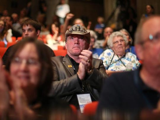 Gregg Cummings of Des Moines applauds after hearing from Gov. Mike Huckabee during the Family Leader Summit on Saturday, July 18, 2015, at Stephens Auditorium in Ames, Iowa.