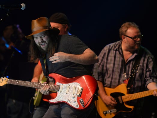 Cole Vosbury and his family on stage during the 2014 James Burton International Guitar Festival Saturday Aug. 23, 2014 at the Municipal Auditorium in Shreveport, Louisiana.