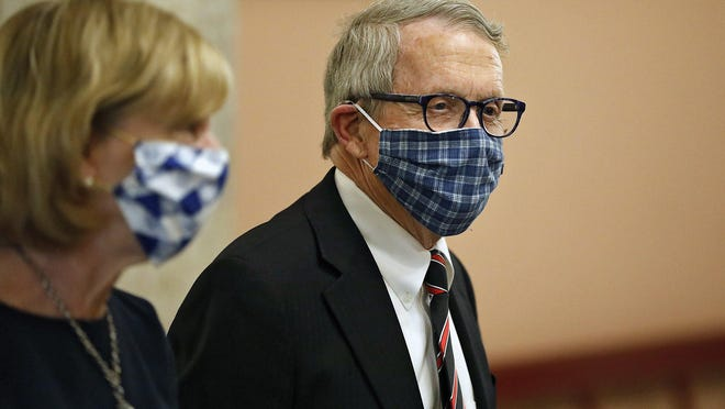 Ohio Gov. Mike DeWine and First Lady Fran DeWine leave the State Room after giving update on the state's response to the ongoing COVID-19 pandemic on Friday, April 10, 2020 at the Ohio Statehouse in Columbus, Ohio.