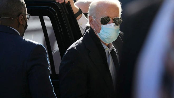 President-elect Joe Biden arrives at the Queen Theater to participate in a virtual roundtable with frontline health care workers on Nov. 18, 2020, in Wilmington, DE.
