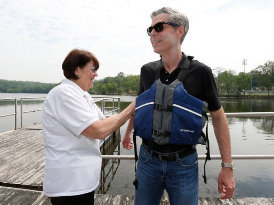 City of White Plains Mayor Tom Roach, right, dons a floation device with City of White Plains Dept. of Parks and Recreation Deputy Commissioner Fran Croughan on Silver Lake at Liberty Park in North White Plains on Friday, May 27, 2016.