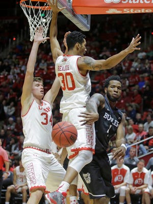 Butler forward Tyler Wideman (right) passes the ball as Utah's Gabe Bealer (30) and Jayce Johnson (34) defend in the first half during an NCAA college basketball game Monday, Nov. 28, 2016, in Salt Lake City.