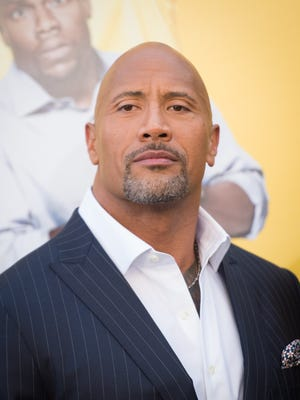 """Actor Dwayne Johnson attends the premiere of Warner Bros. Pictures' """"Central Intelligence"""" at Westwood Village Theatre on June 10, 2016 in Westwood, California."""