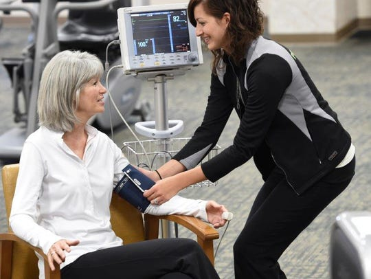 Exercise physiologist Brittany Raup works with a patient