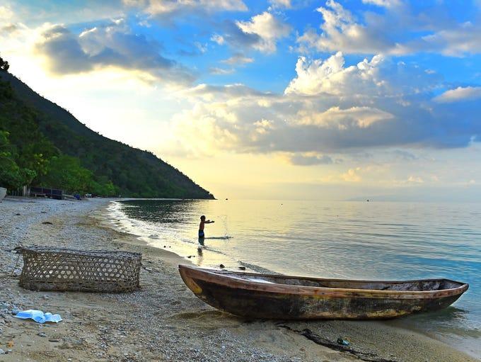 A Haitian child plays at sunset  on Taino Beach, Grand