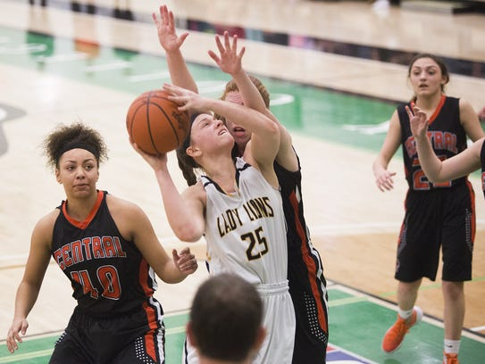 Red Lion's Courtney Dimoff drives to the hoop on Central