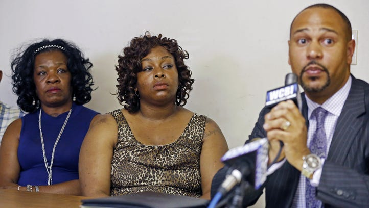 """Peggy Shumpert, wife of the deceased, center, and Dollie Jones, mother, left, listen as their attorney Carlos Moore discusses the death of Antwun """"Ronnie"""" Shumpert. Peggy Shumpert, wife of the deceased, center, Dollie Jones, mother, left, listen during a July 6, 2016, news conference as their attorney, Carlos Moore, details the evidence he has sent to various agencies and media outlets, alleging Tupelo police officer Tyler Cook shot 37-year-old Antwun """"Ronnie"""" Shumpert without due cause."""