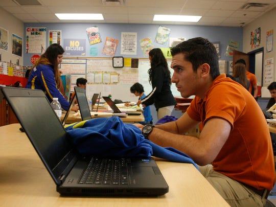 An IDEA Pharr College Prep high school student works on an assignment during an art class at the South Texas charter school.