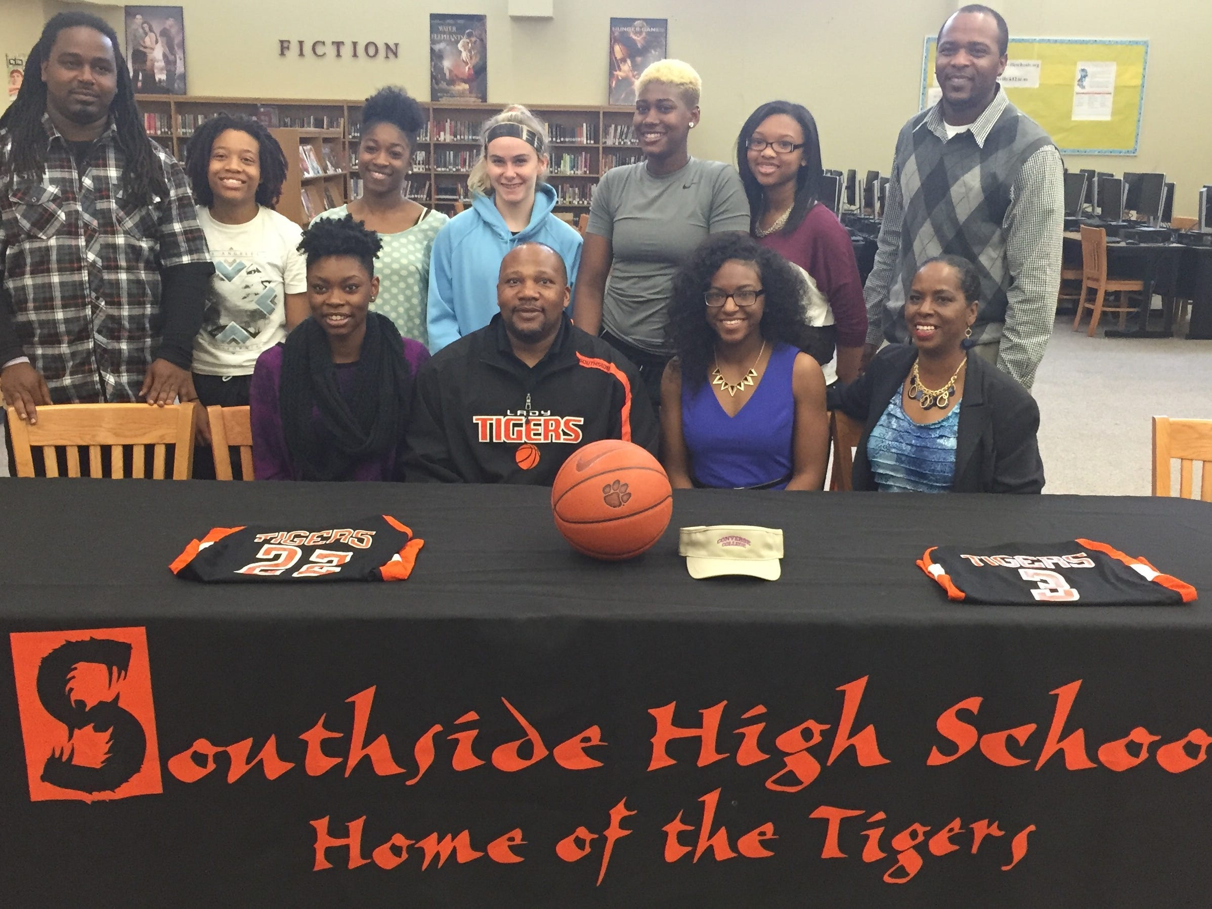 Southside High School seniors Khrystal Ellis, front left, and Paige Johnson, front second from right, signed to play basketball at Converse College.
