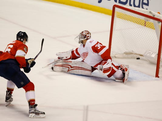 Florida Panthers center Aleksander Barkov (16) scores against Detroit Red Wings goaltender Petr Mrazek (34) during the second period of an NHL hockey game, Saturday, Feb. 3, 2018 in Sunrise, Fla. (AP Photo/Wilfredo Lee)