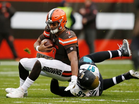 Cleveland Browns quarterback DeShone Kizer (7) is sacked by Jacksonville Jaguars defensive tackle Malik Jackson (97) in the first half during an NFL football game, Sunday, Nov. 19, 2017, in Cleveland. (AP Photo/Ron Schwane)