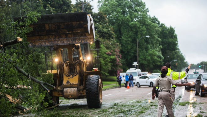 June 23, 2017 - City of Memphis traffic officers divert traffic after a tree fell and blocked a lane near 2450 Union Ave. on Friday. Wind gusts from a morning storm were reported from 30 mph to 40 mph in Memphis.
