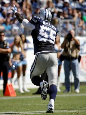 Dallas Cowboys middle linebacker Rolando McClain runs with an interception against the Titans.