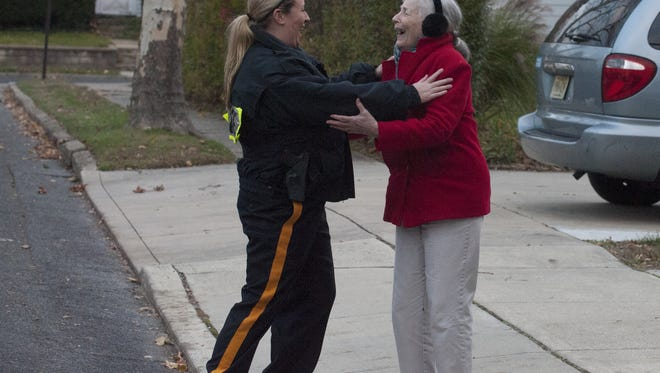Woodbury's Police, Sgt. Kelli Marro  interacts with resident Norma Knight during a walk shift around the streets of town. The new police Chief Tom Ryan is going back to the old days, when cops stomped the beat with foot patrols through town. In October and November, officers were assigned walking shifts through Woodbury neighborhoods with the sole purpose of connecting with the community. Patrols begin again next week. We walk with officers through sections of Woodbury.