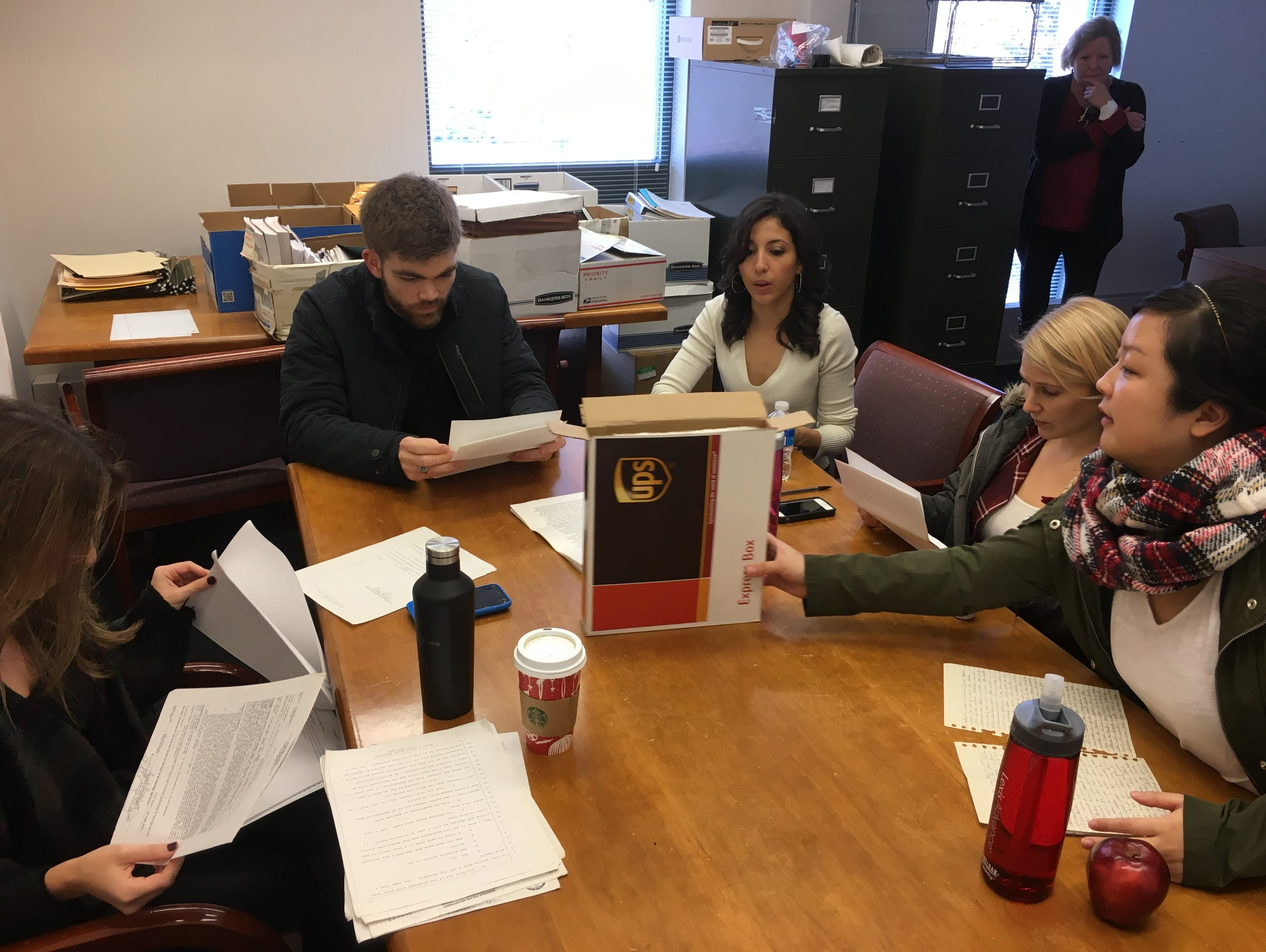 Students at the pro bono clinic work on a case for