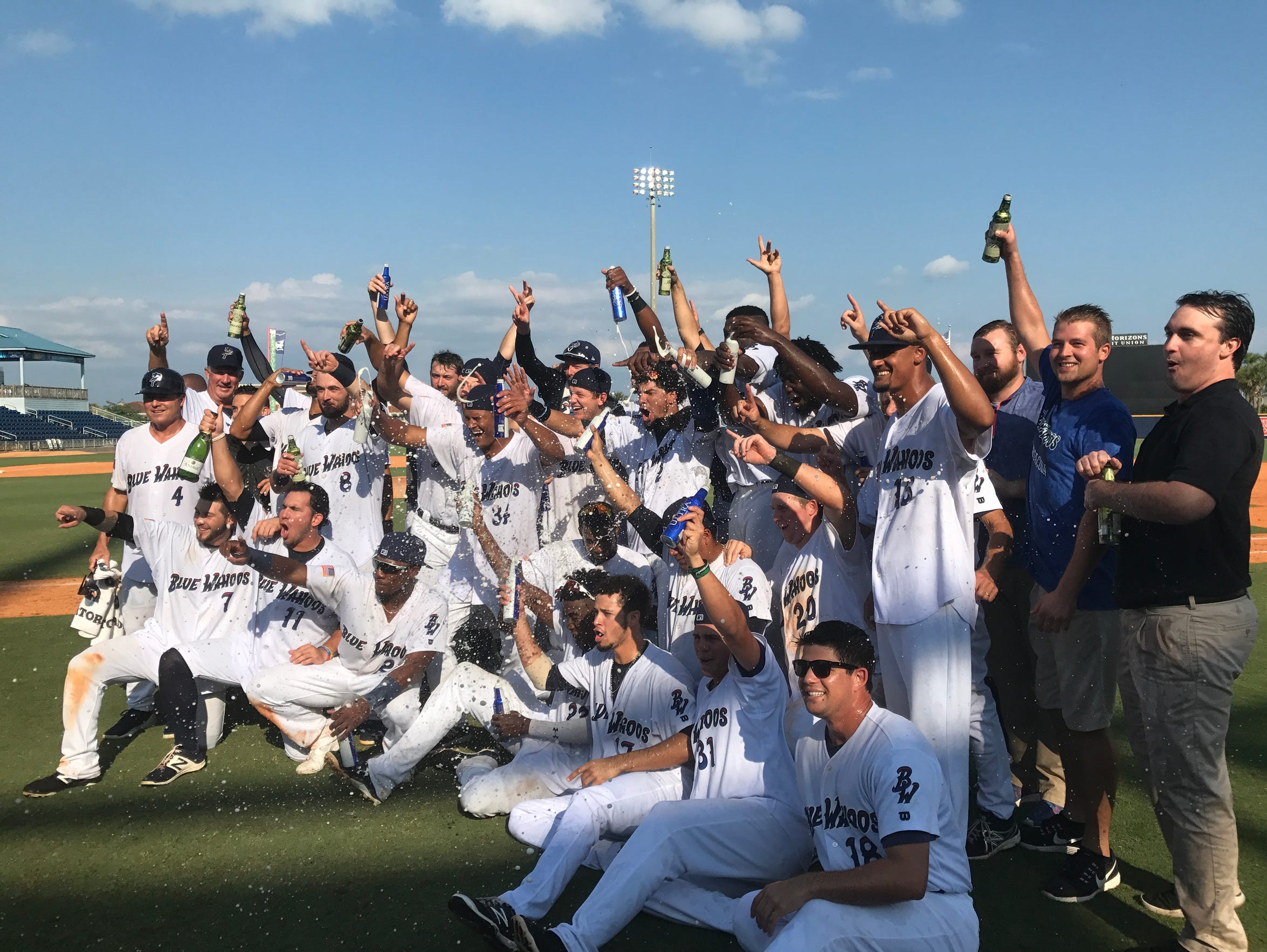 The Blue Wahoos celebrate their Southern League co-championship after a 12-inning victory against the Jacksonville Jumbo Shrimp and sweep of the division championship series.