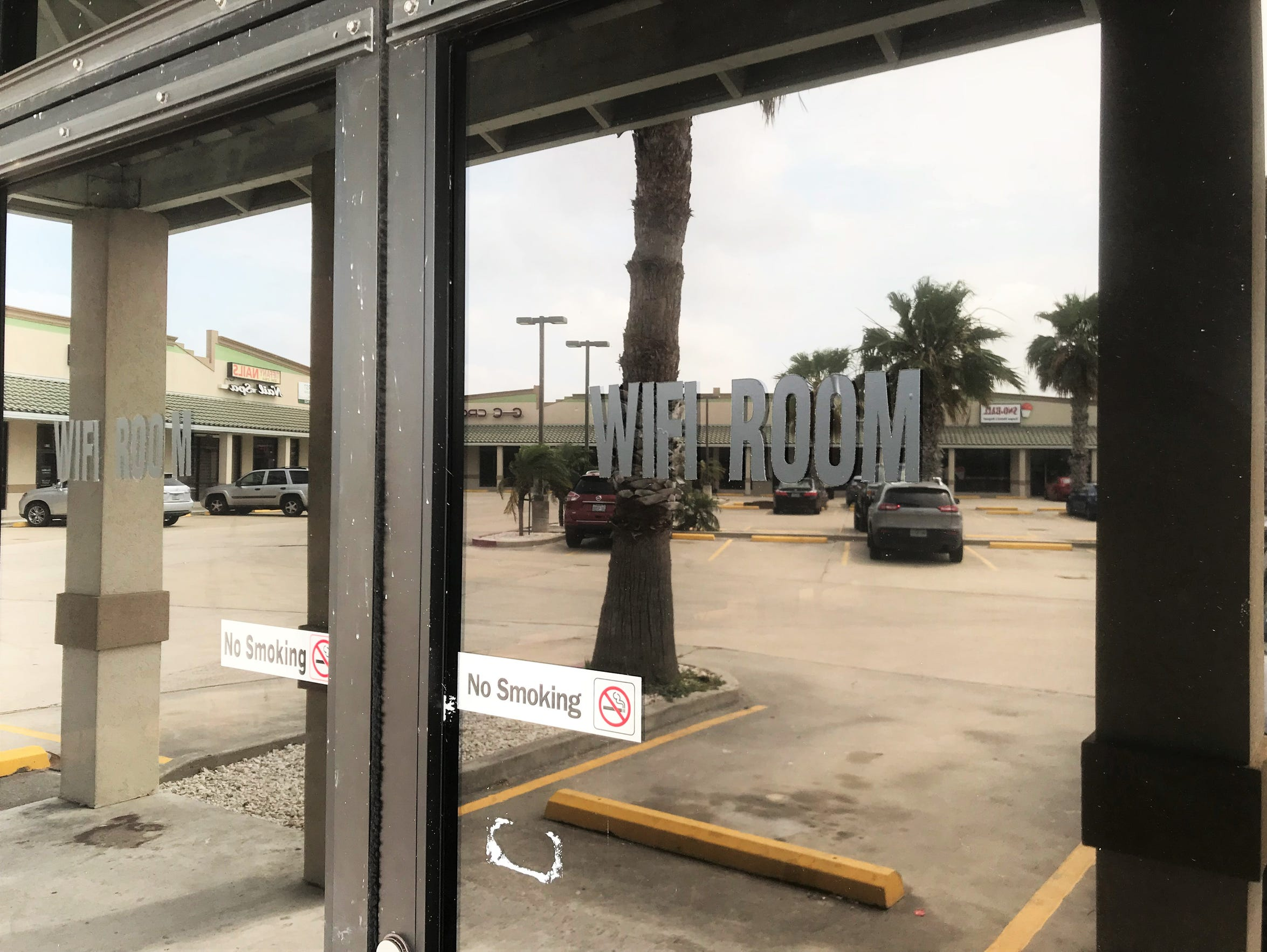Black lettering announcing a business in Marbella Plaza,
